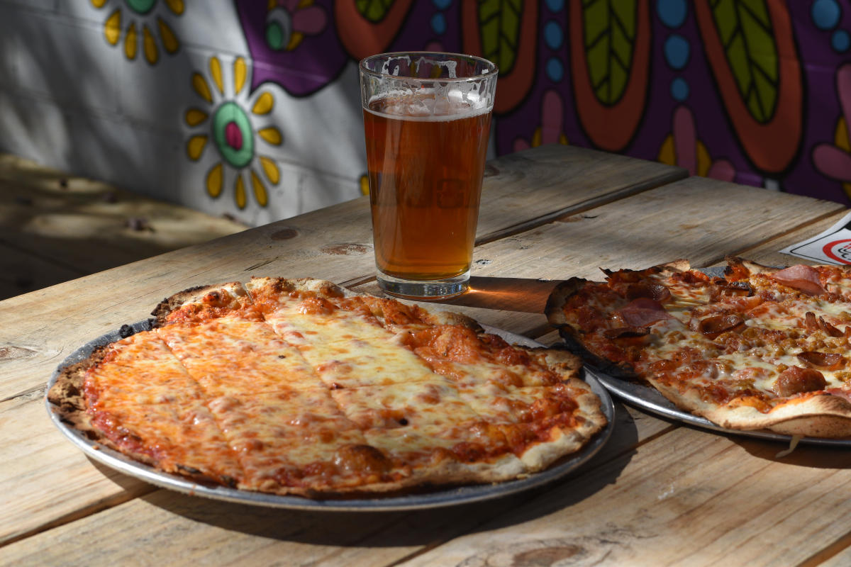 pizza and beer on a patio table