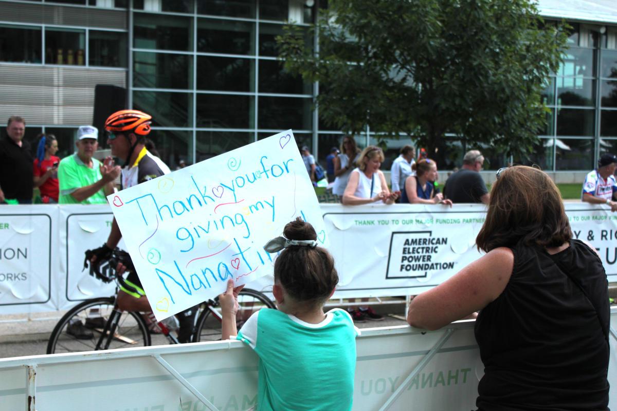 Fans cheer on a Pelotonia Rider