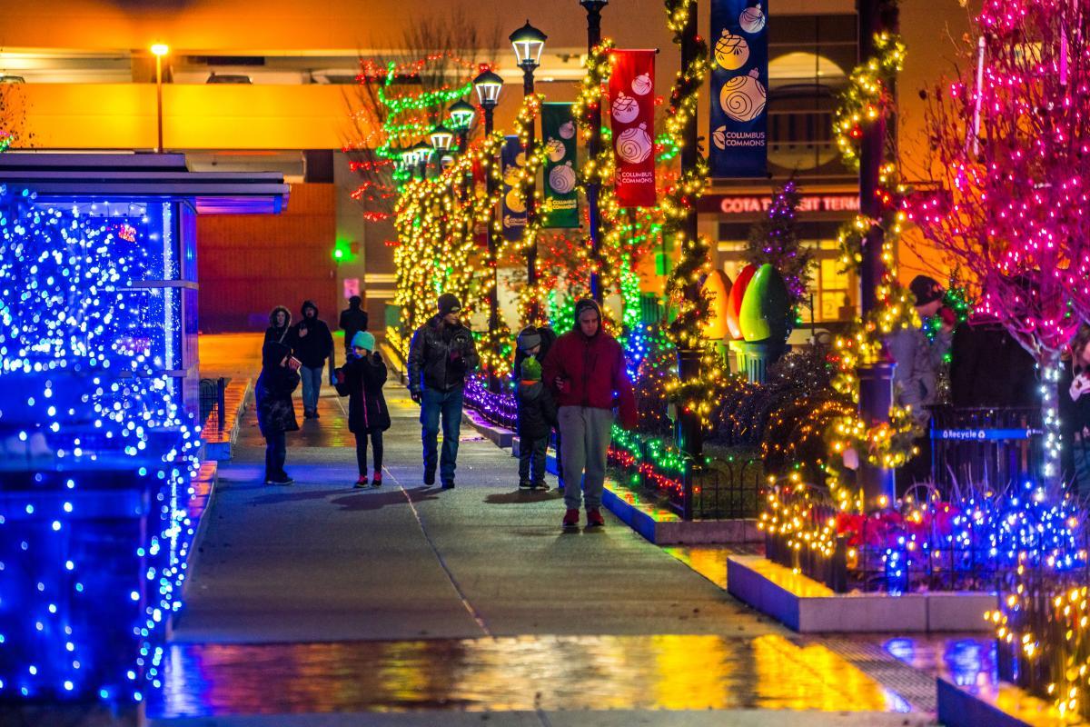 People enjoying holiday light display at Columbus Commons