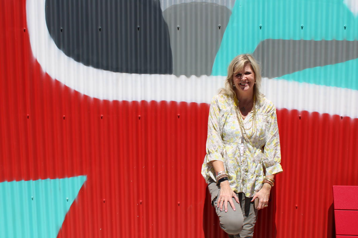 Easton Chief Executive Jennifer Peterson poses in front of a mural
