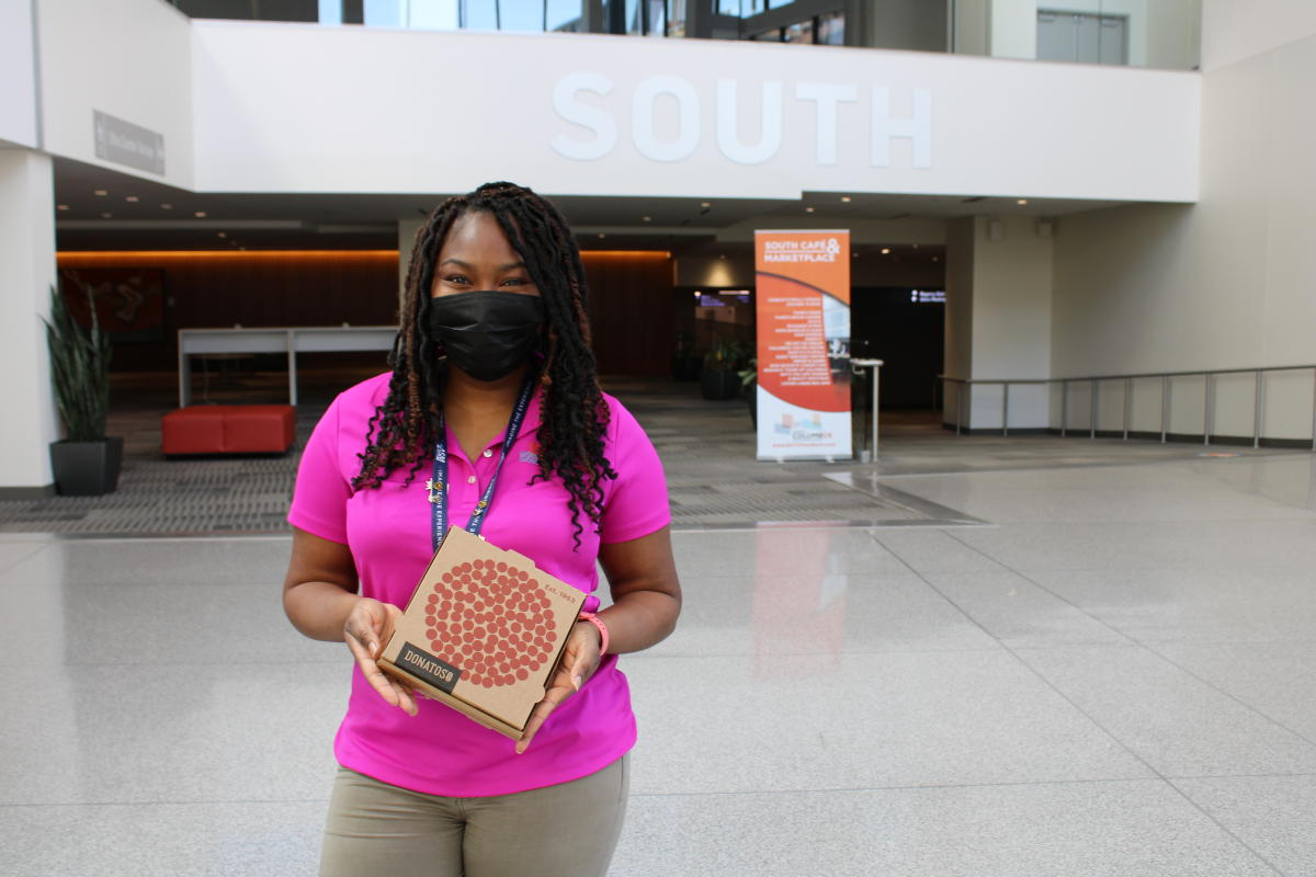 Greater Columbus Convention Center's Leslie Nutter with Donatos Pizza