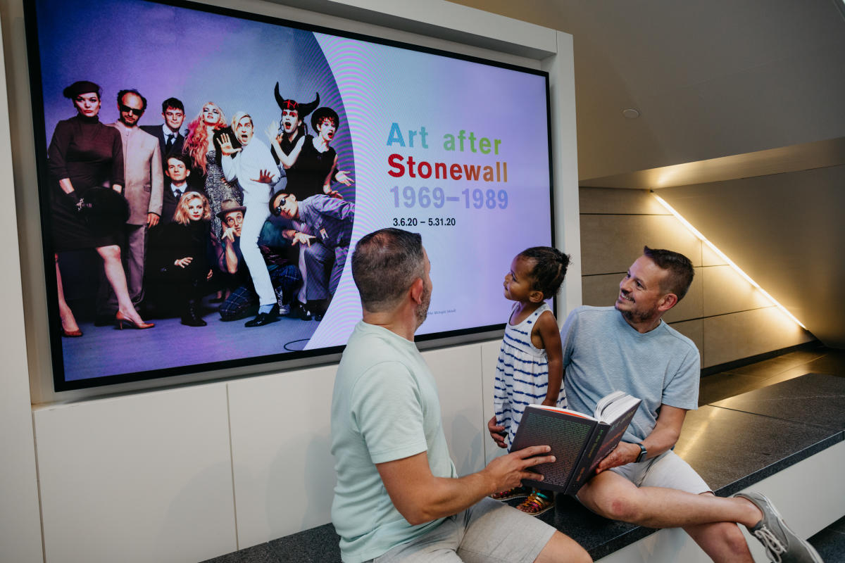 Couple and their daughter viewing the Art After Stonewall exhibit at the Columbus Museum of Art