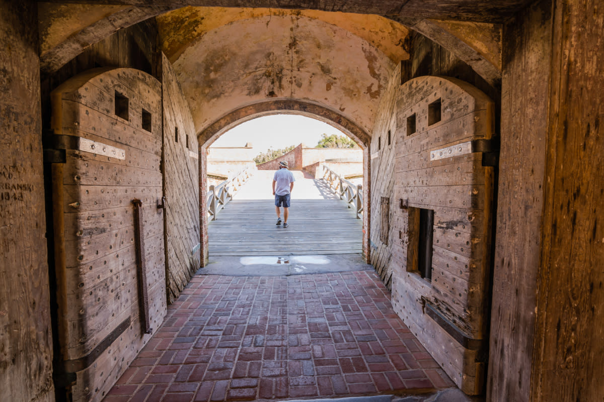 A visitor explores the history of Fort Macon State Park.