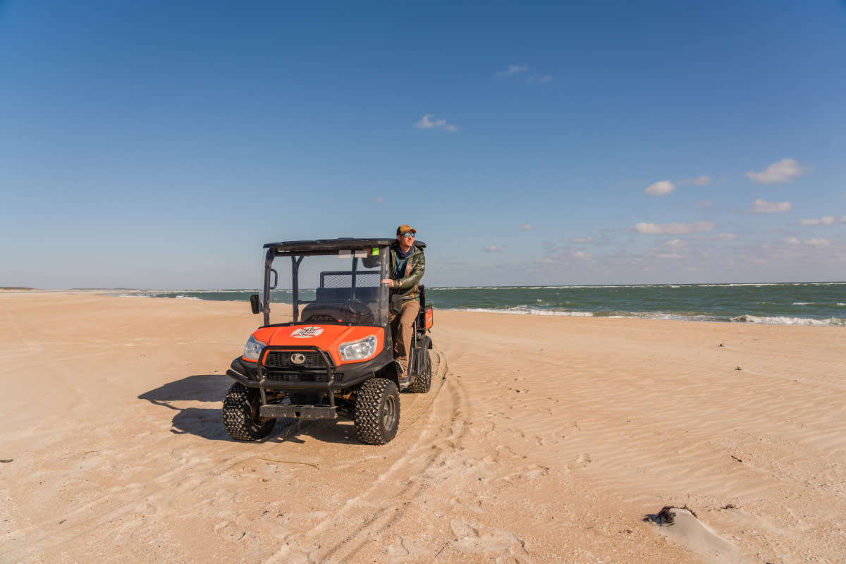 A visitor surveys the Cape Lookout National Seashore from a rental Kubota ATV.