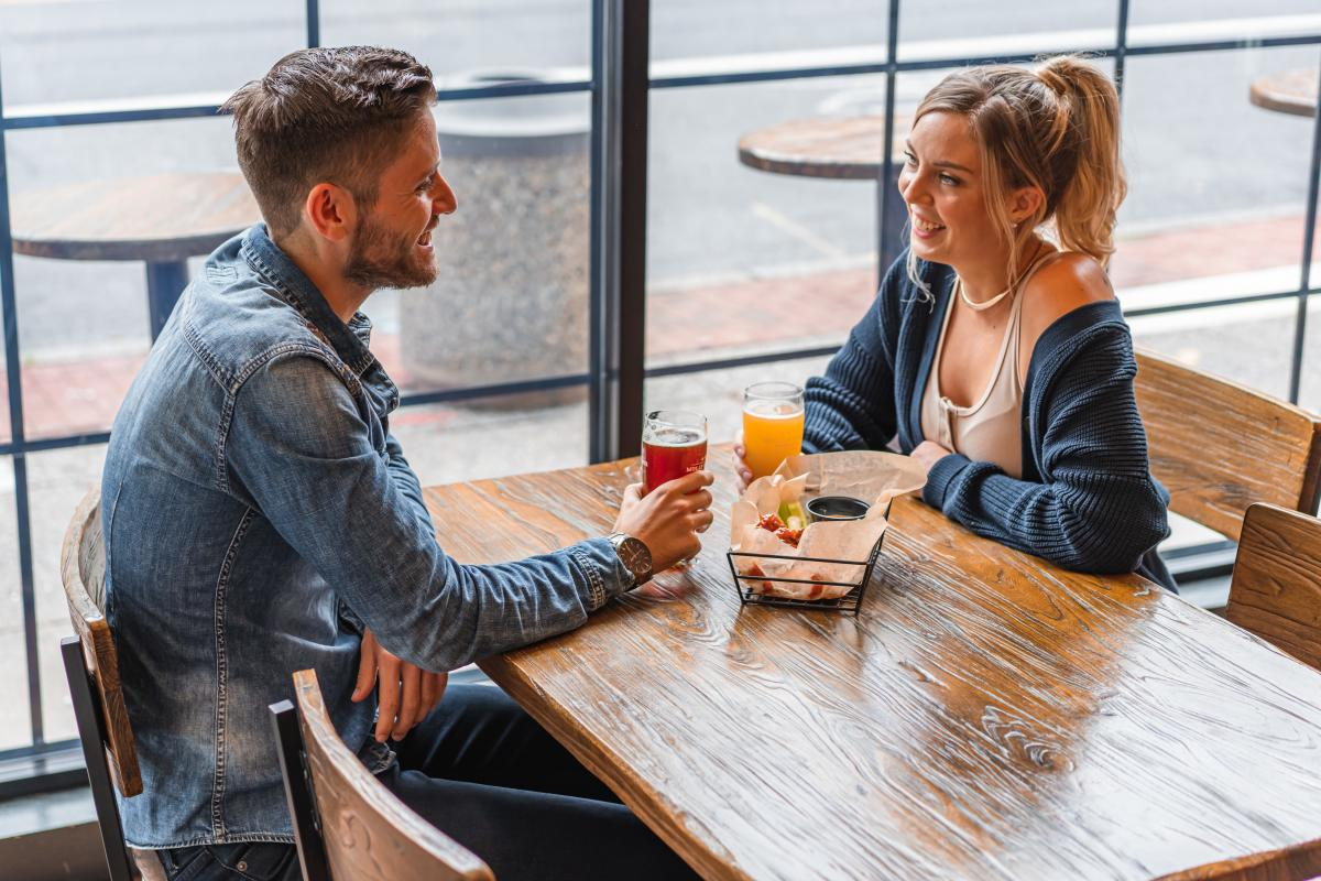 Couple drinking craft beers with an appetizer at Molly Pitcher Brewing Company