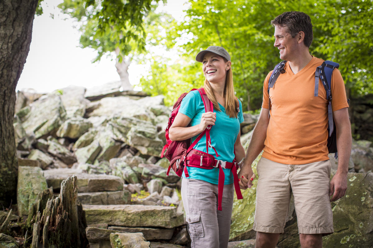 Couple wearing backpacks and holding hands at Waggoner's Gap