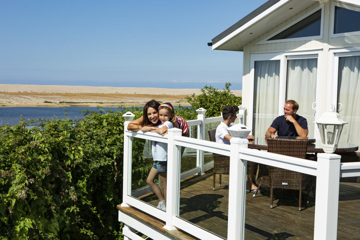 Family at outside the accommodation at Chesil Vista Holiday Park