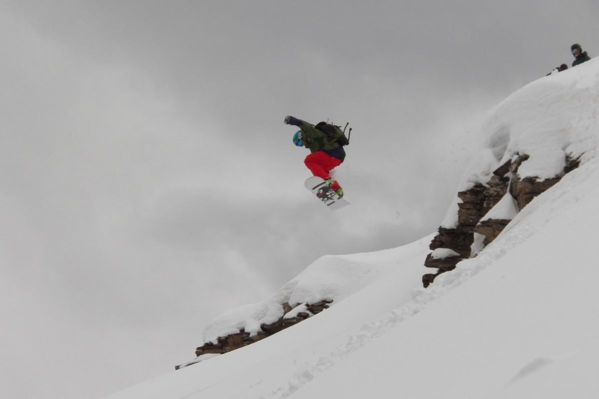 Snowboarder Jumping at Purgatory Resort