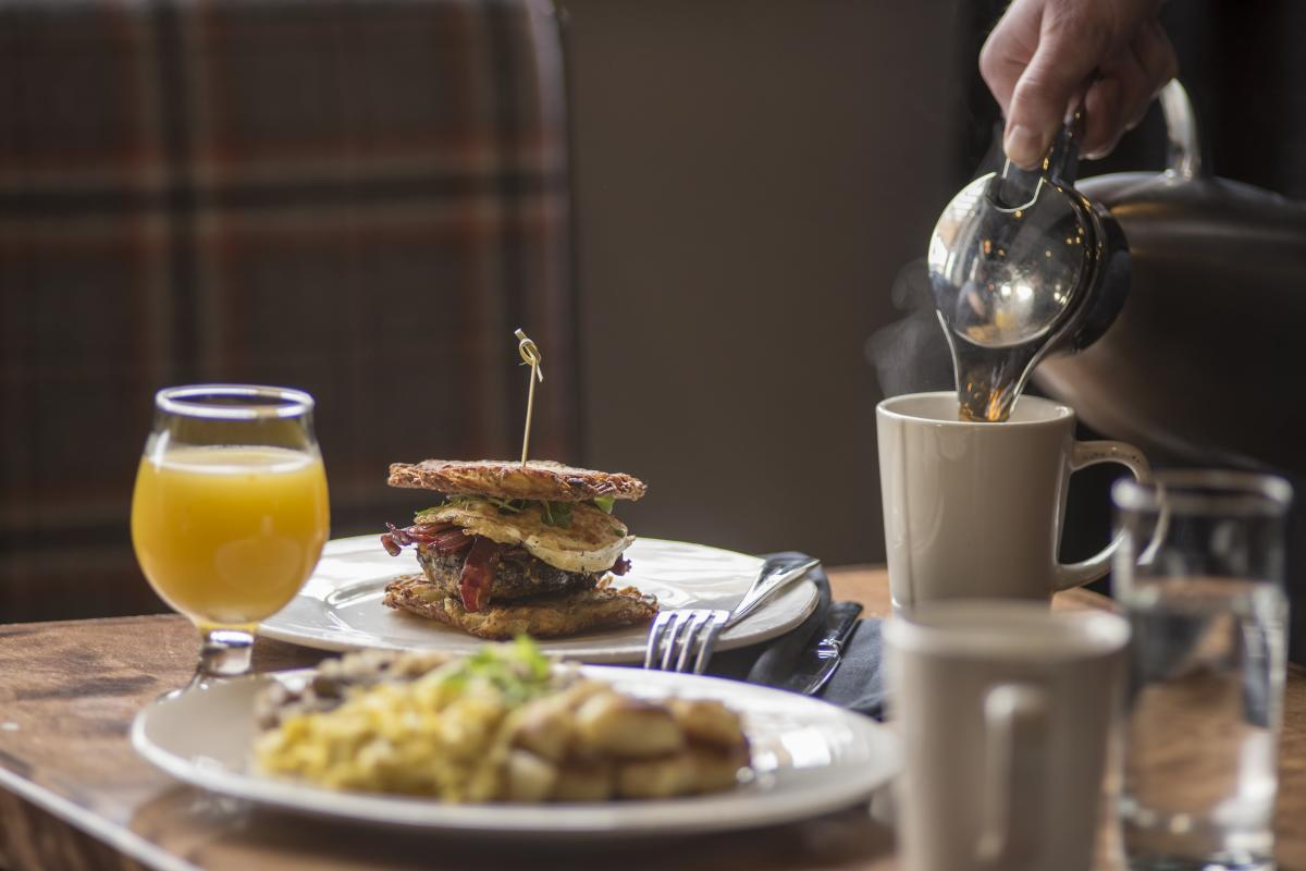 Breakfast sandwich and a plate of eggs at The Lakely in the Oxbow Hotel