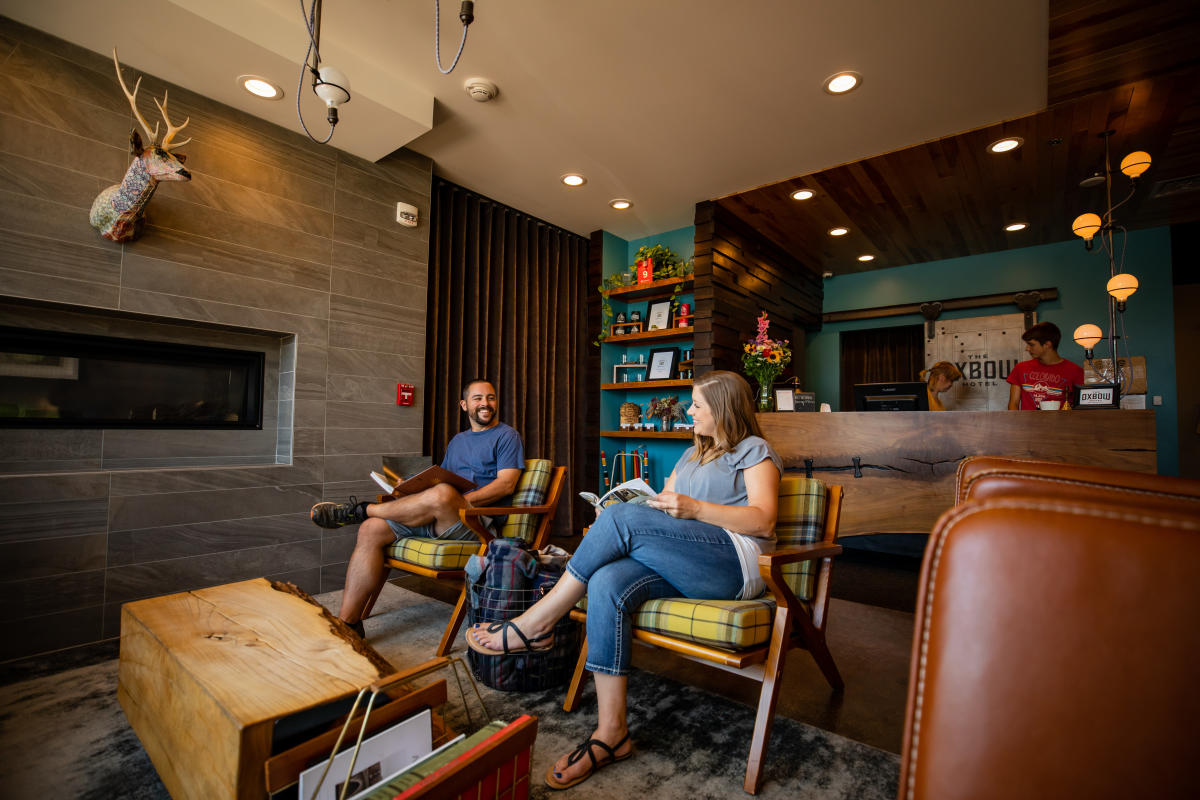 Couple sitting in the lobby at The Oxbow Hotel