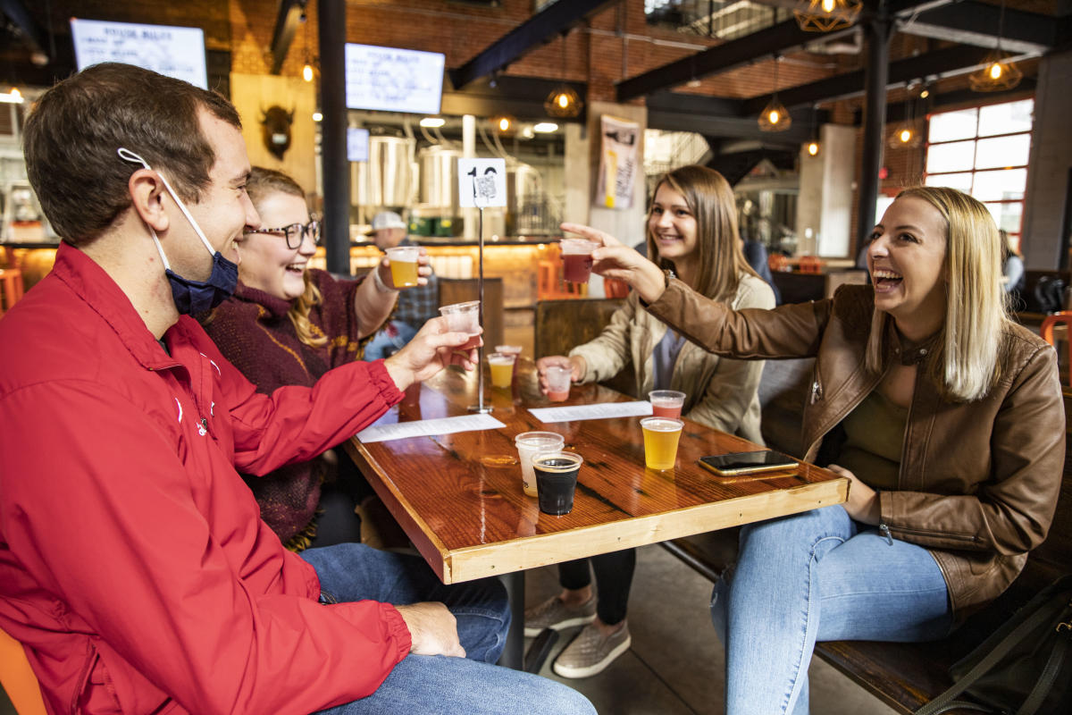 Group cheers with beer samplers at The Brewing Projekt