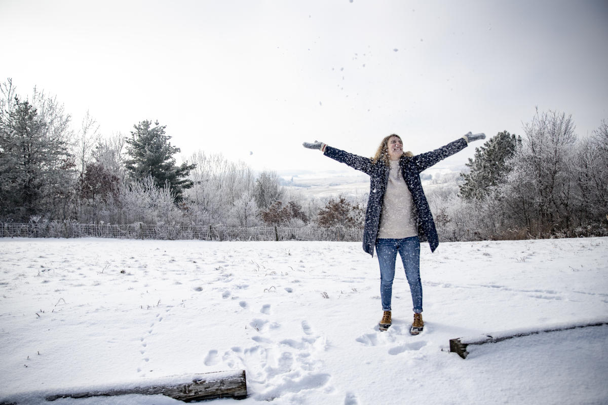 Woman standing in the snow at the Buena Vista Scenic Overlook in Osseo in the winter