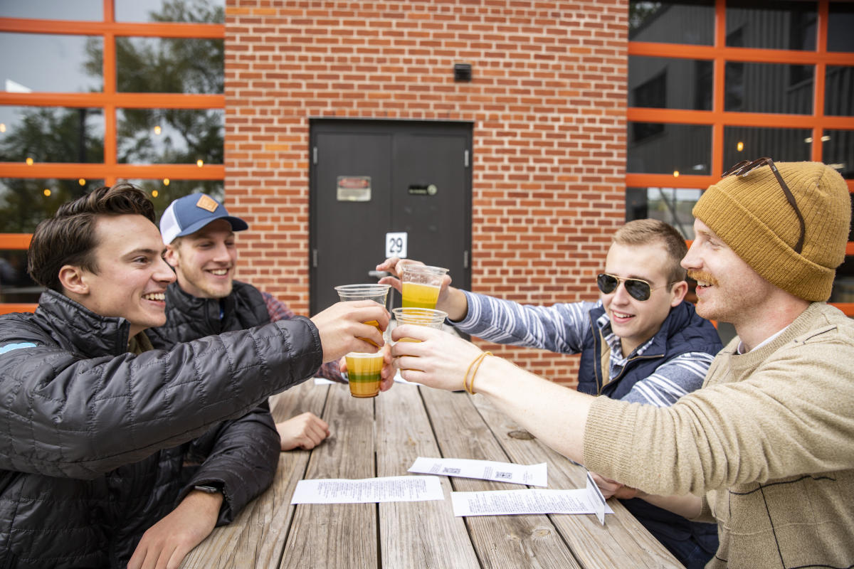 Group of guys drinking beers at the Brewing Projekt
