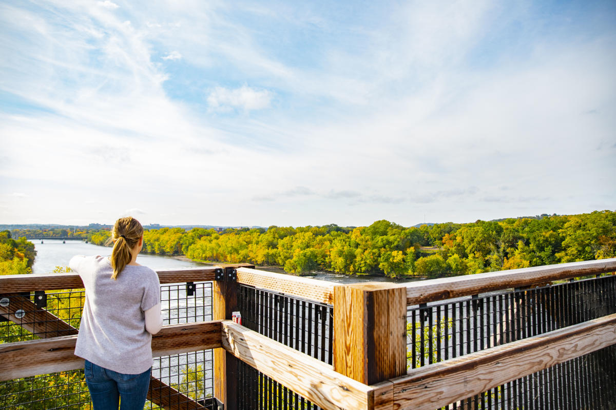 Woman looking out at the view at High Bridge in the fall