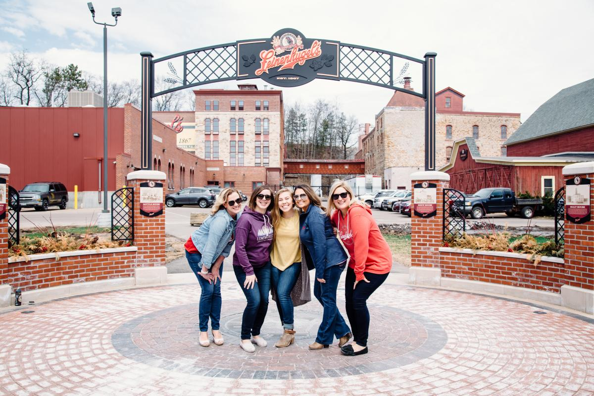 Group of five women posing together for a photo at Leinenkugel's Brewery in Chippewa Falls, WI