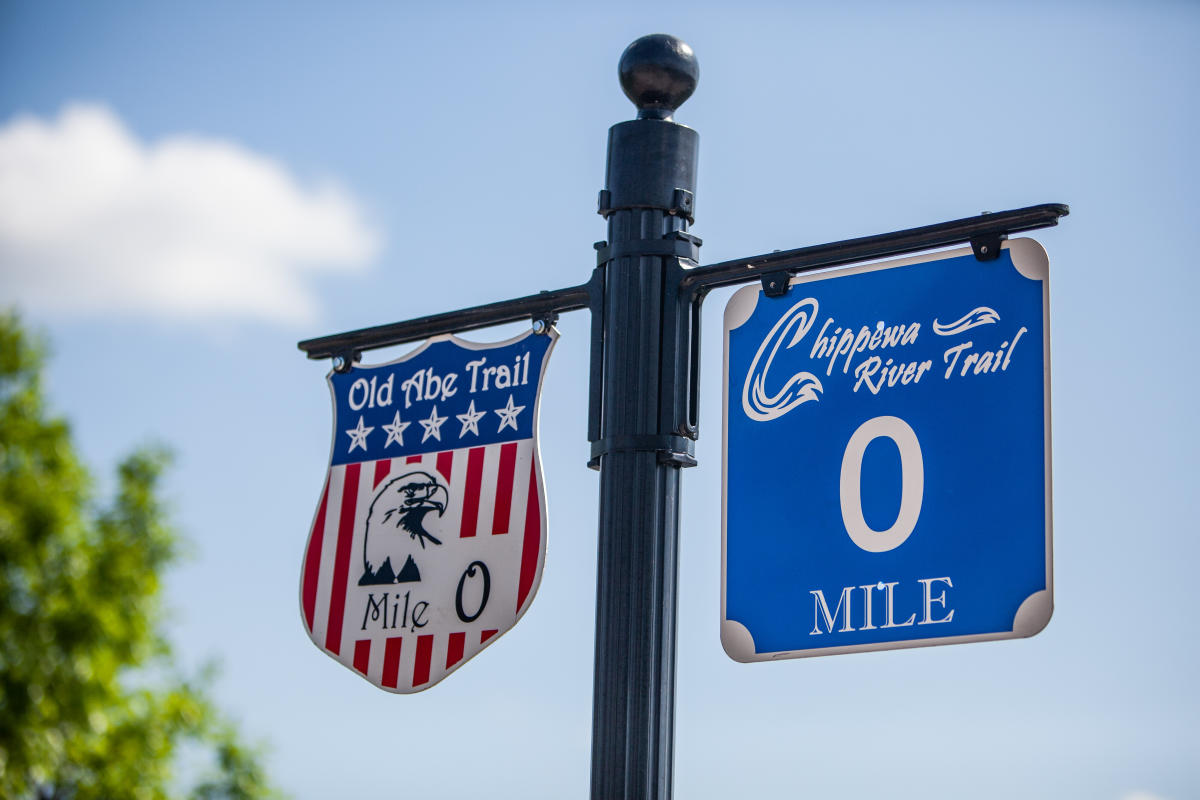 Signs for the start of the Chippewa River State Trail and the Old Abe State Trail