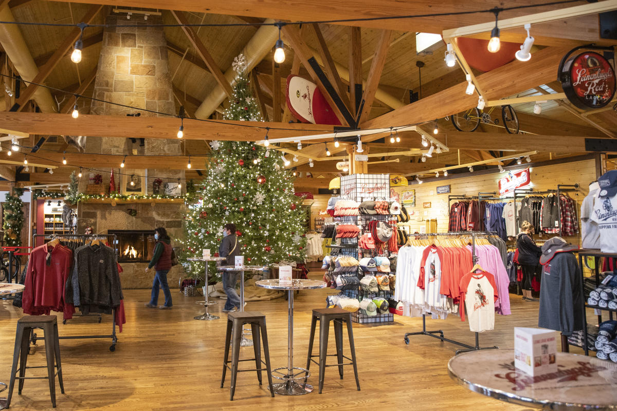 Shoppers at Leinie Lodge among Christmas decorations