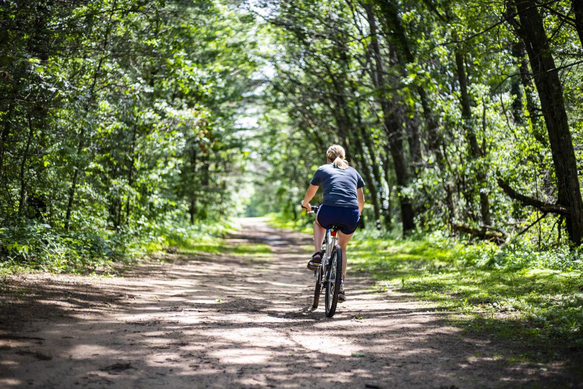 Woman mountain biking on trail at Lowes Creek