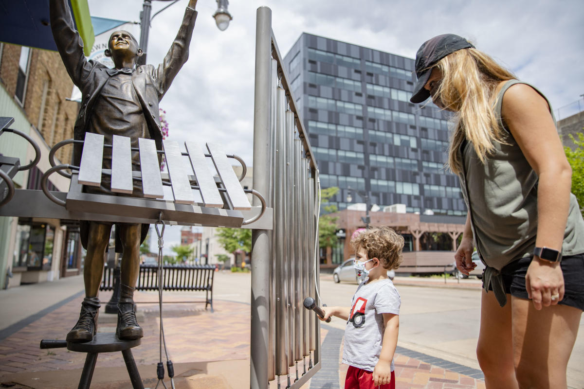 Mother and son enjoying sculptures in downtown Eau Claire