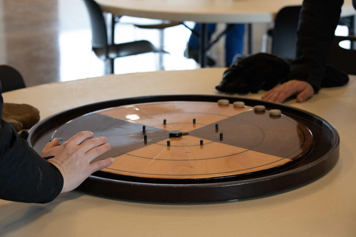 A crokinole board, a game invented in Canada