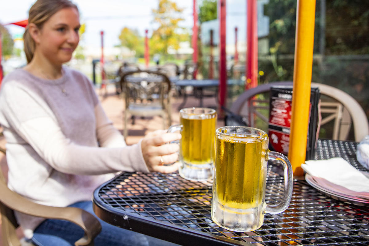 Enjoying beers on the outdoor patio at Wisco's