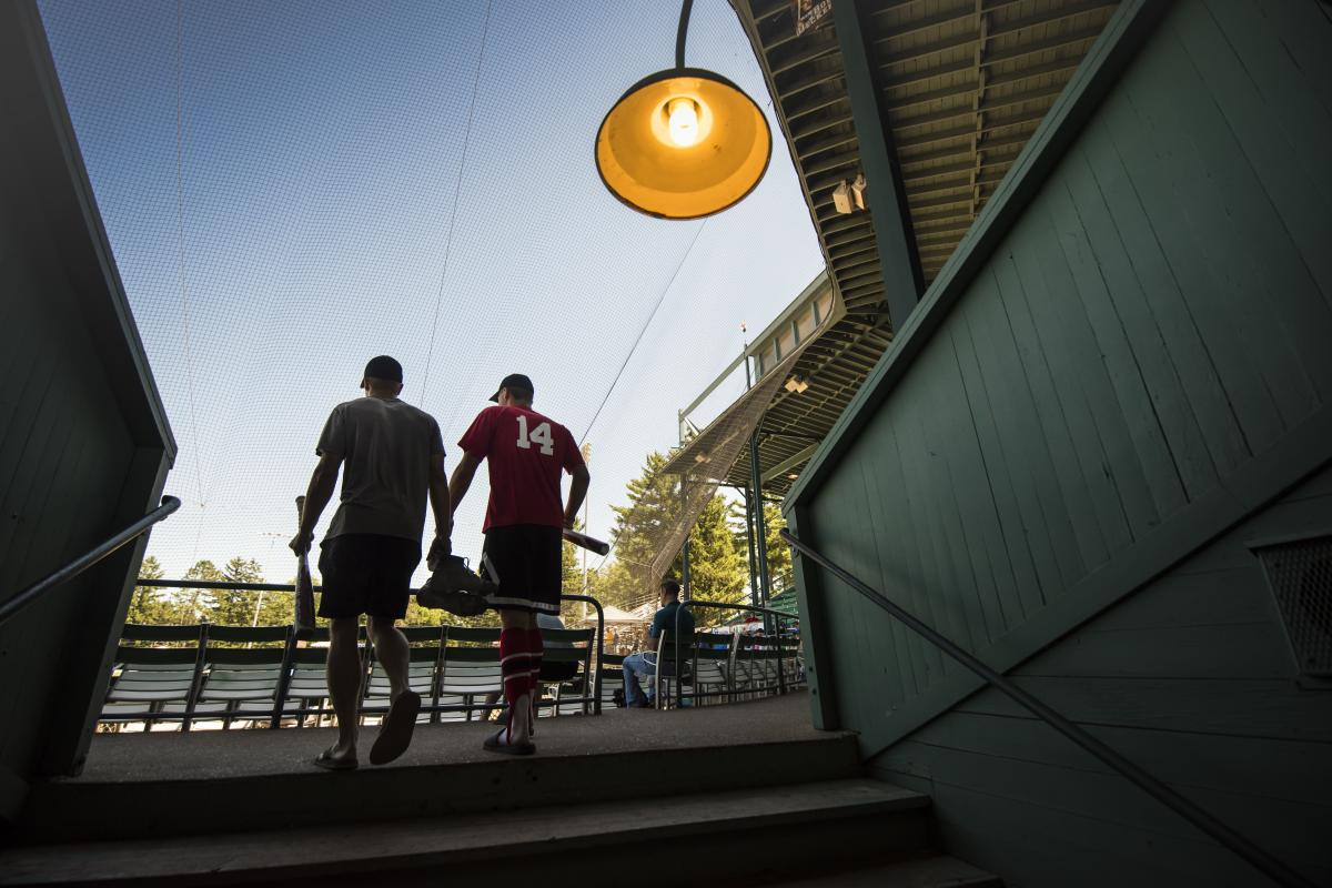 2 people walking into the Carson Park stadium for an Eau Claire Express baseball game