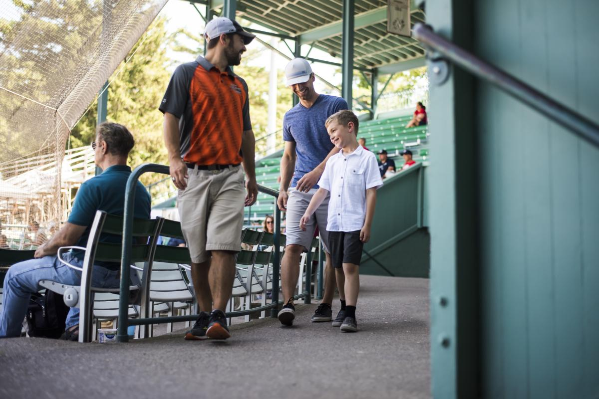 Father and son enjoy the Eau Claire Express MVP Signature Experience at Carson Park.
