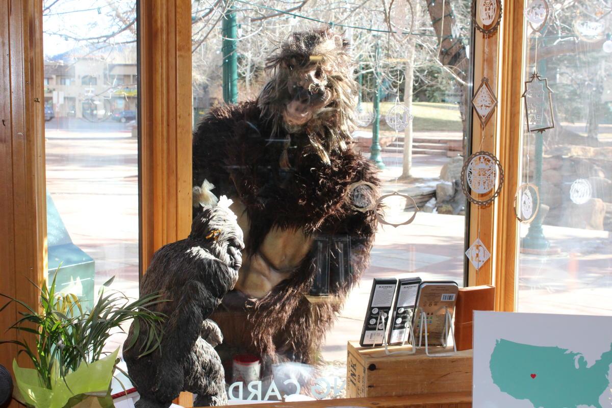 bigfoot looking in inkwell & brew's window