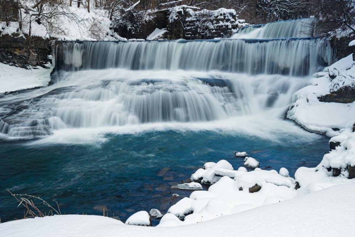 Seneca Mills Waterfall in winter on the Keuka Lake Outlet Trail in Finger Lakes Wine Country New York