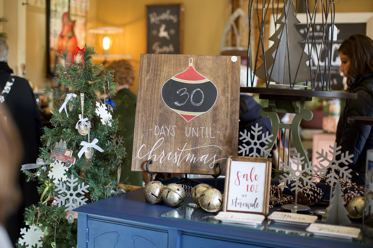 Wood christmas coundown sign during Holly Trolley Shopping