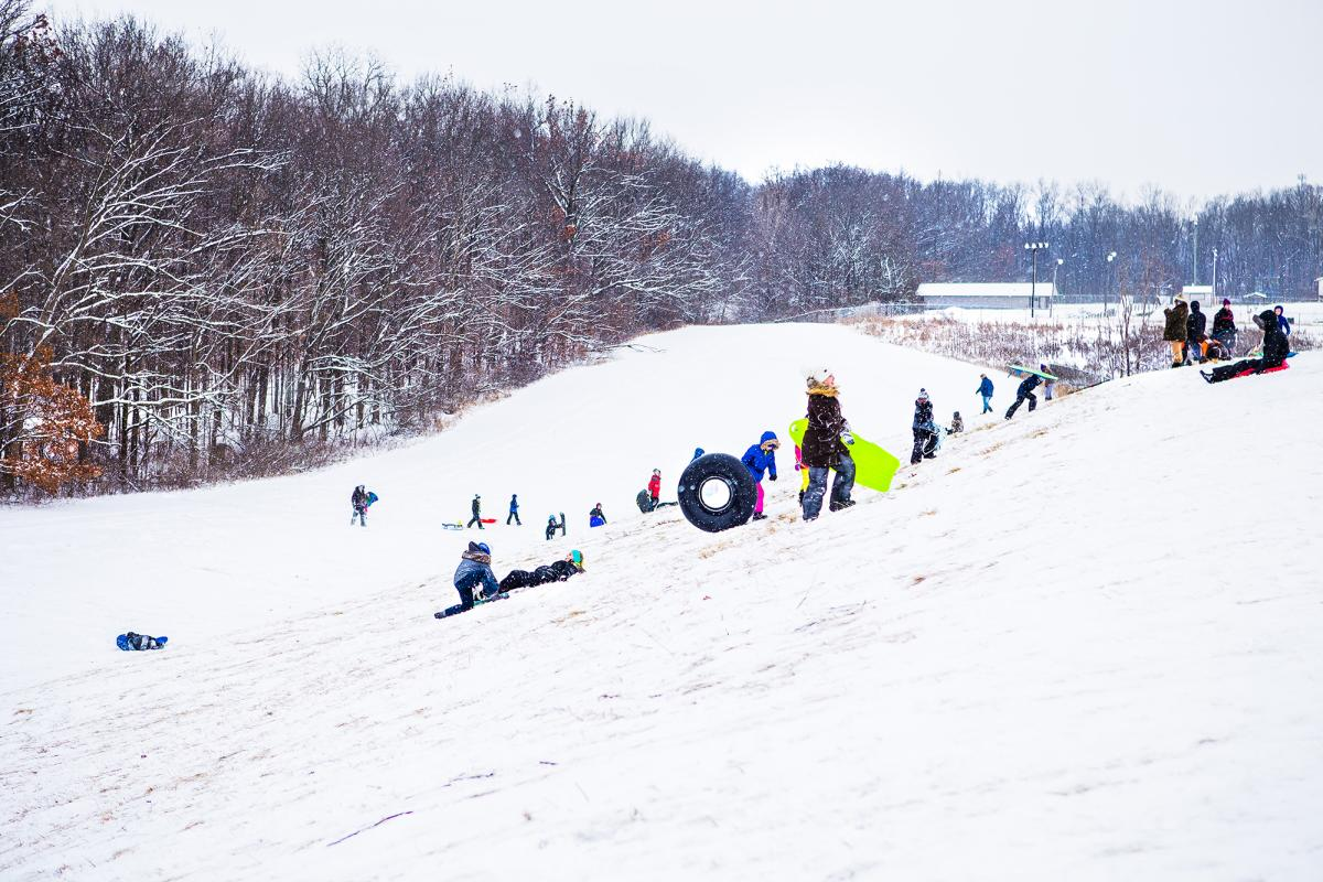 People sledding down the hill at Shoaff Park in Fort Wayne