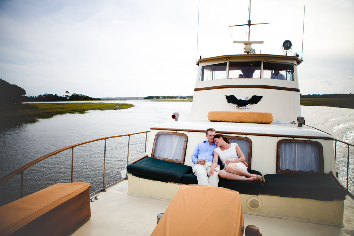 A couple enjoys a private boat tour of the Golden Isles marshes with String of Pearls