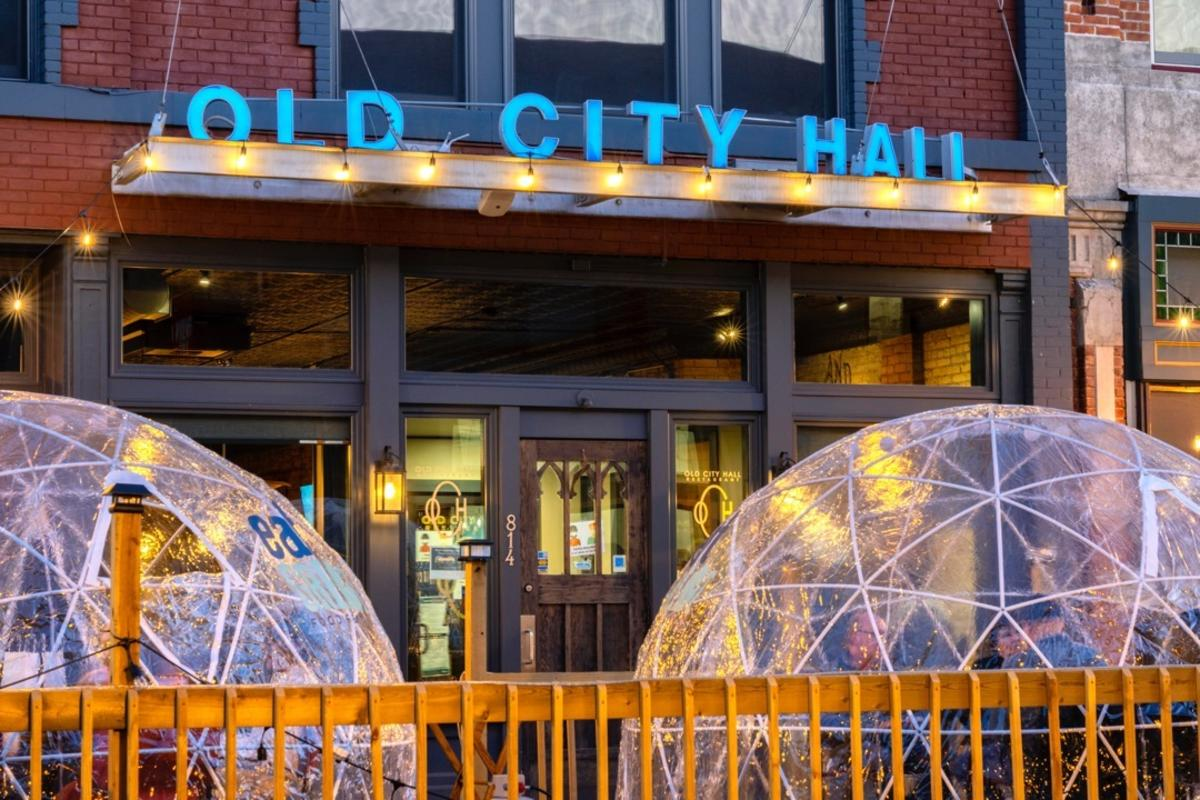 Cozy, heated outdoor igloos for dining in front of Old City Hall in Bay City
