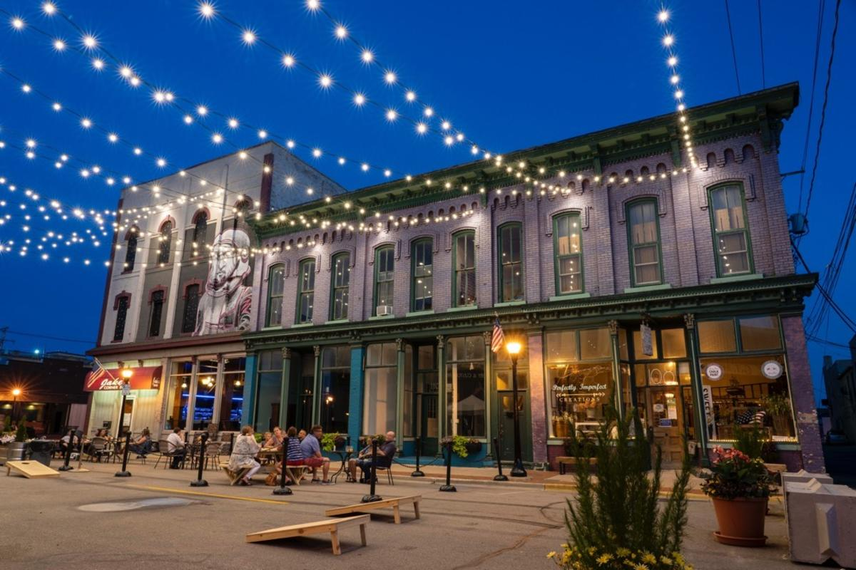 Outdoor dining under the lights of the Third Street Star Bridge in Bay City