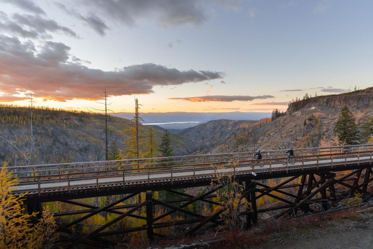 Couple Biking at Myra Canyon Trestles
