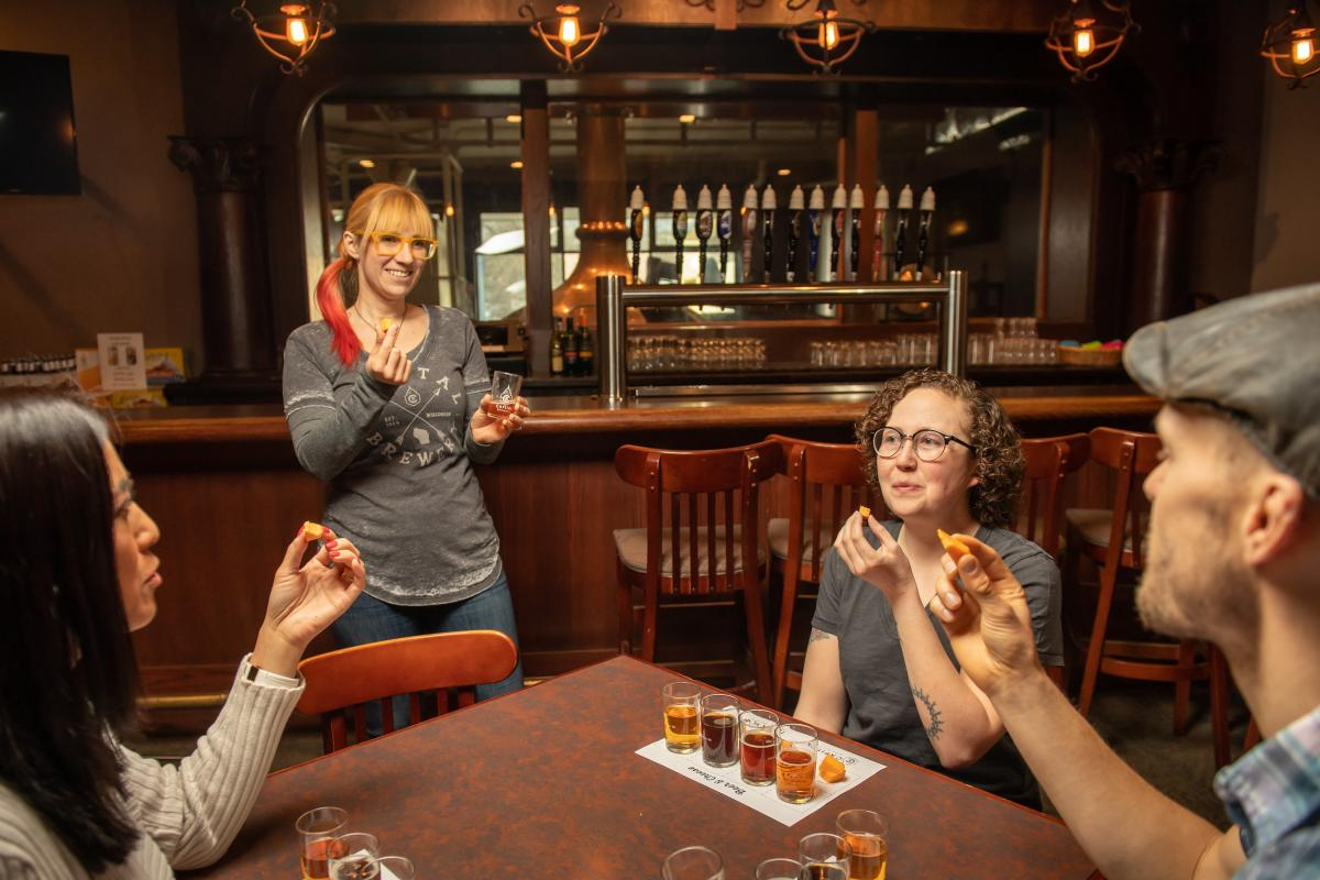 A group samples a beer flights at Capital Brewery