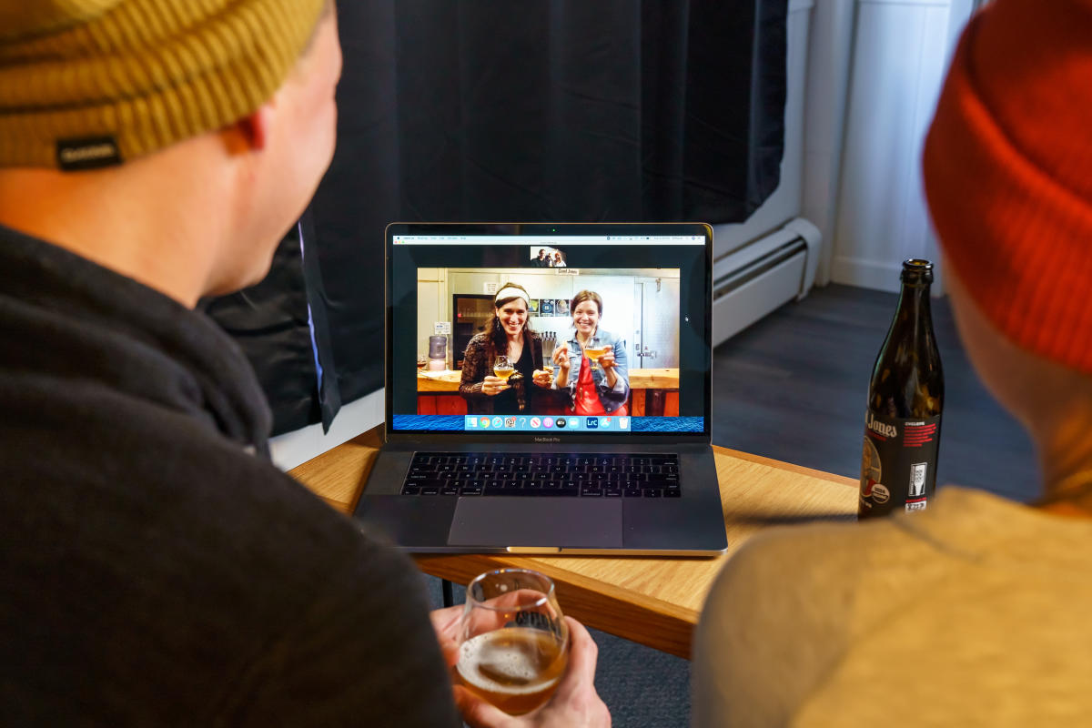 Two people watch the Giant Jones Brewing experience on their laptop