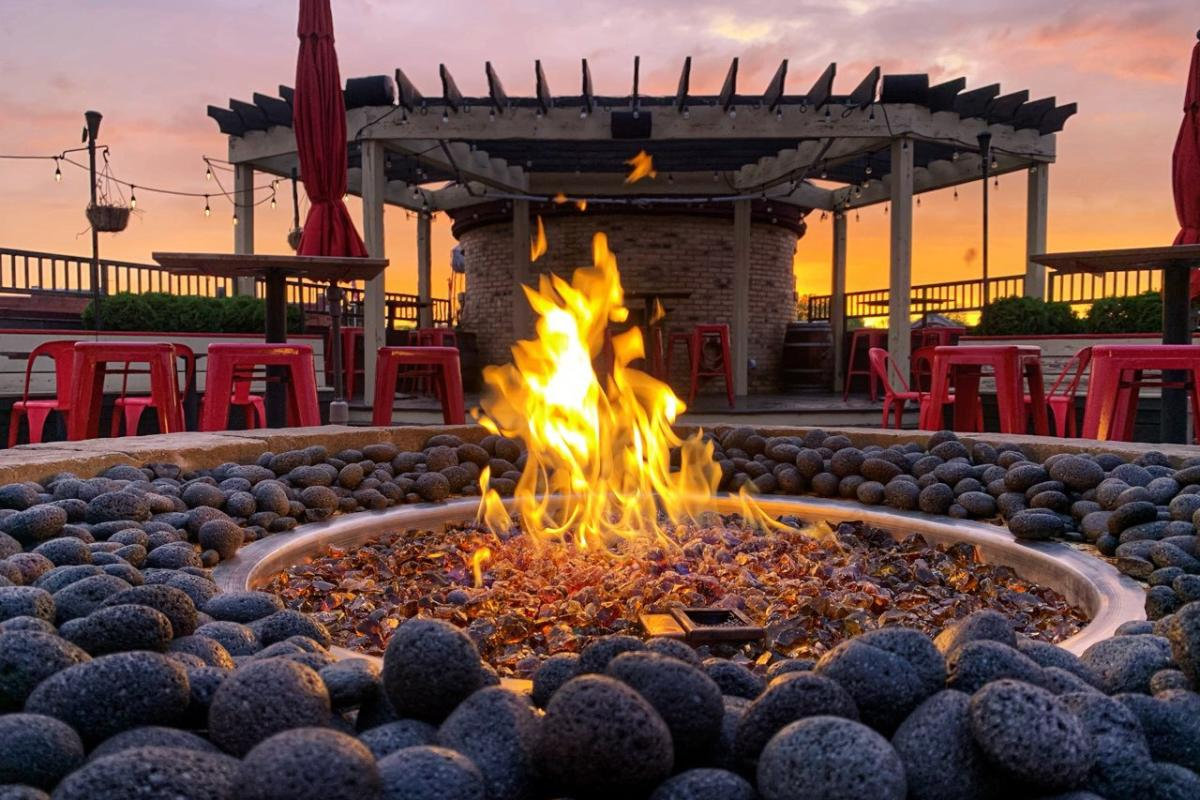 A rooftop fire pit at Lone Girl Brewing