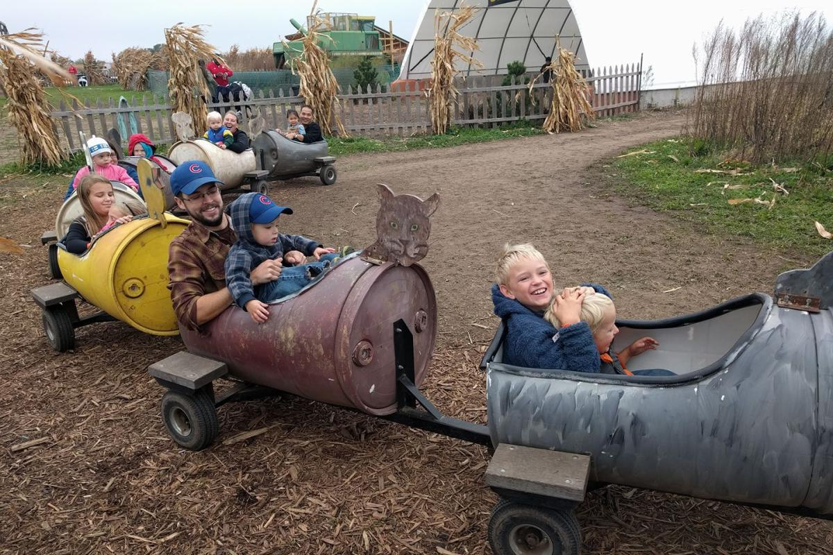 Children ride on the wagon pull at Schuster's Farm