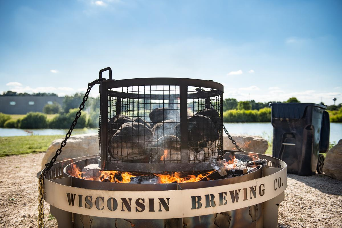 An outdoor fire pit by the lake at Wisconsin Brewing Company