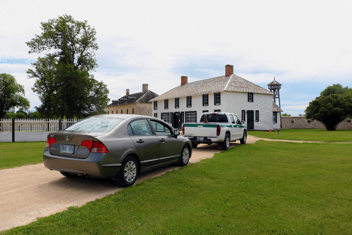 Cars at Lower Fort Garry for the Red River Valley driving tour with Parks Canada