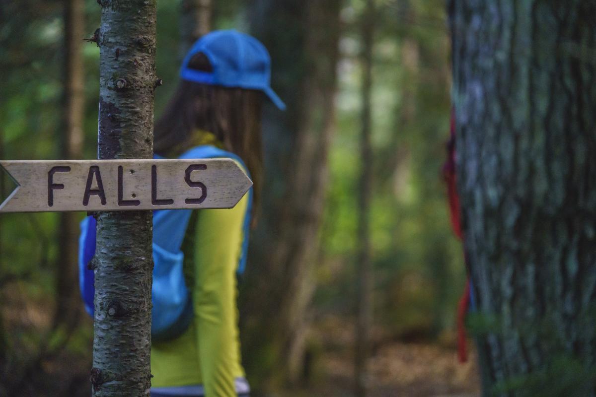 Signage pointing towards the falls at Yellow Dog Falls in Big Bay, MI