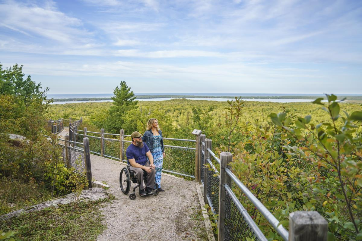 A couple looking out at Thomas Rock Scenic Overlook in Big Bay, MI