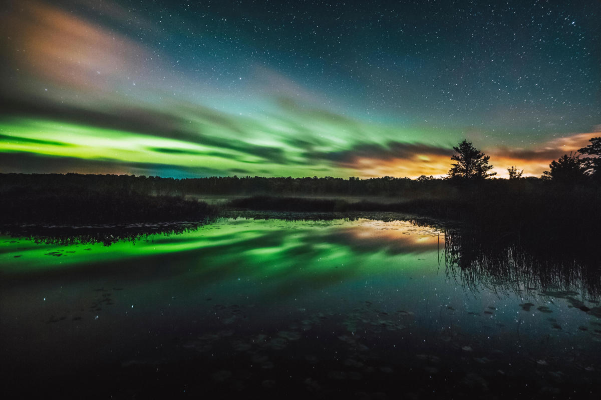 Green Auroras over the sky in Big Bay, MI
