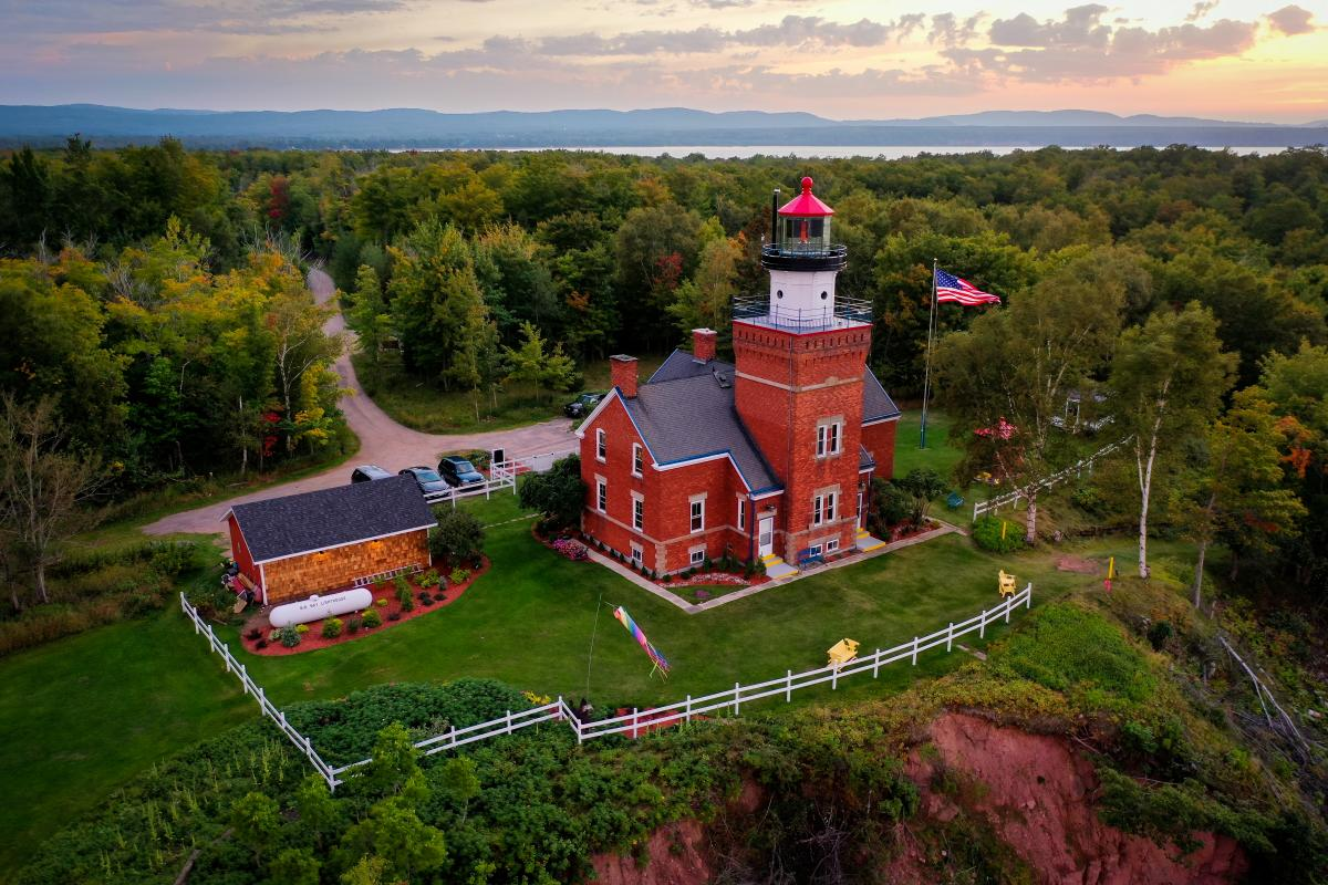 An aerial shot of the picturesque Big Bay Point Lighthouse in Big Bay, MI
