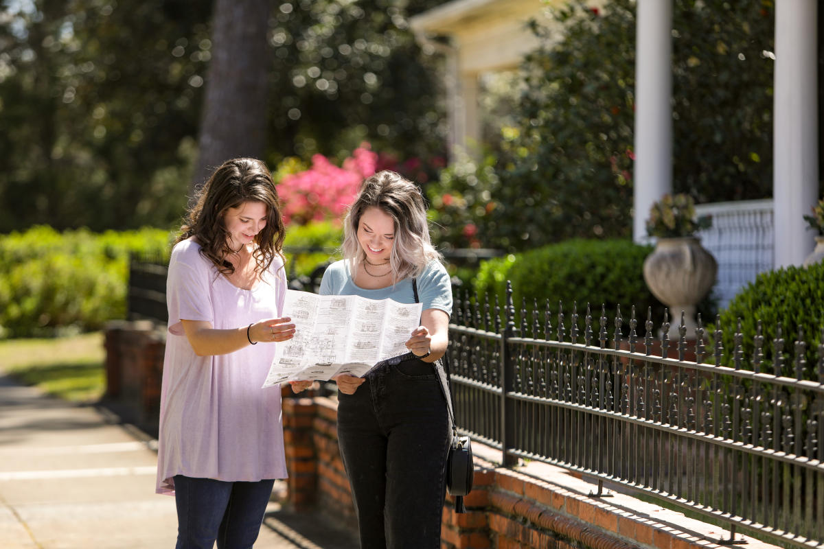 Young women on a historic walking tour in downtown Milledgeville, GA