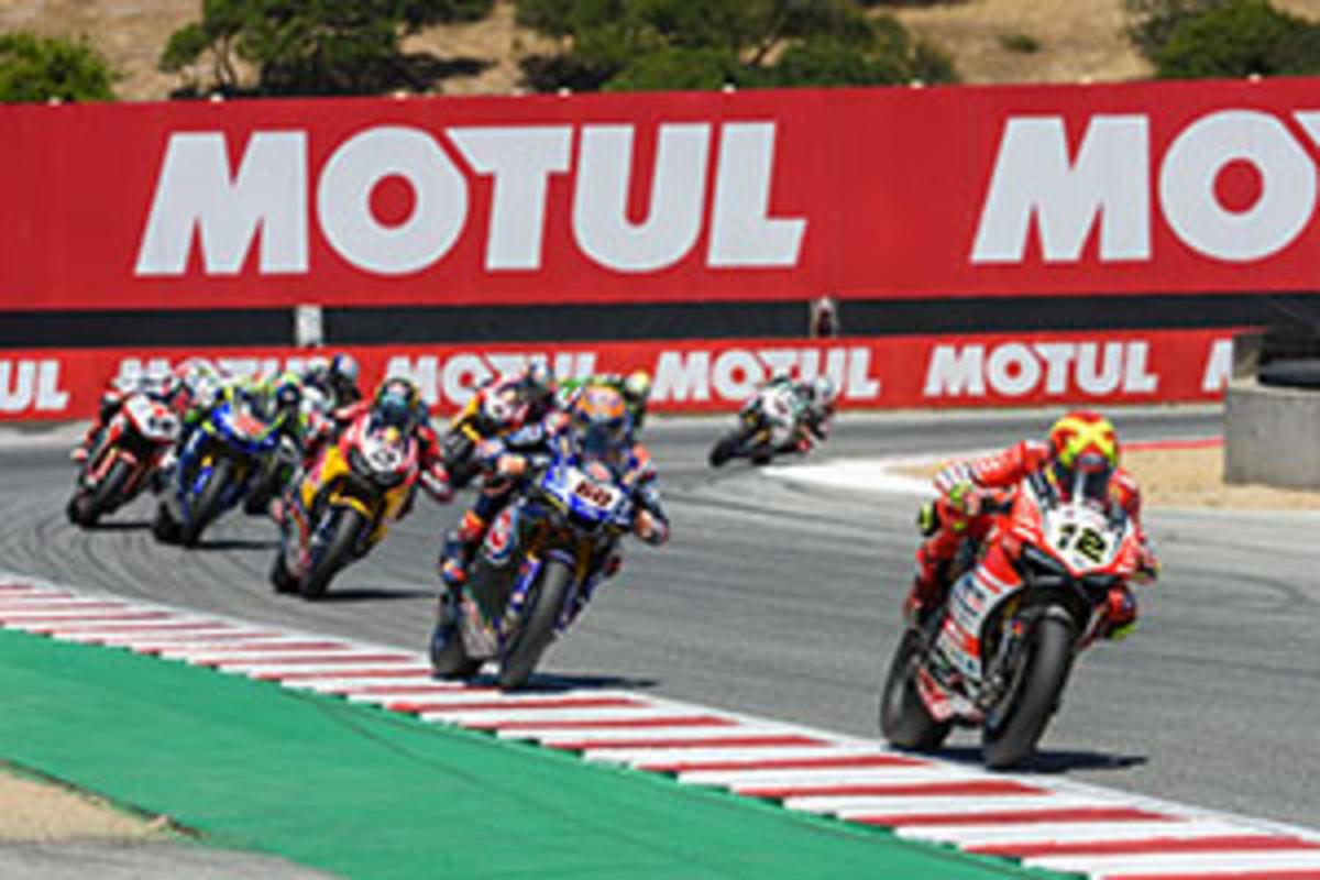 Professional motorcycle racers round the corner at WeatherTech Raceway Laguna Seca, CA