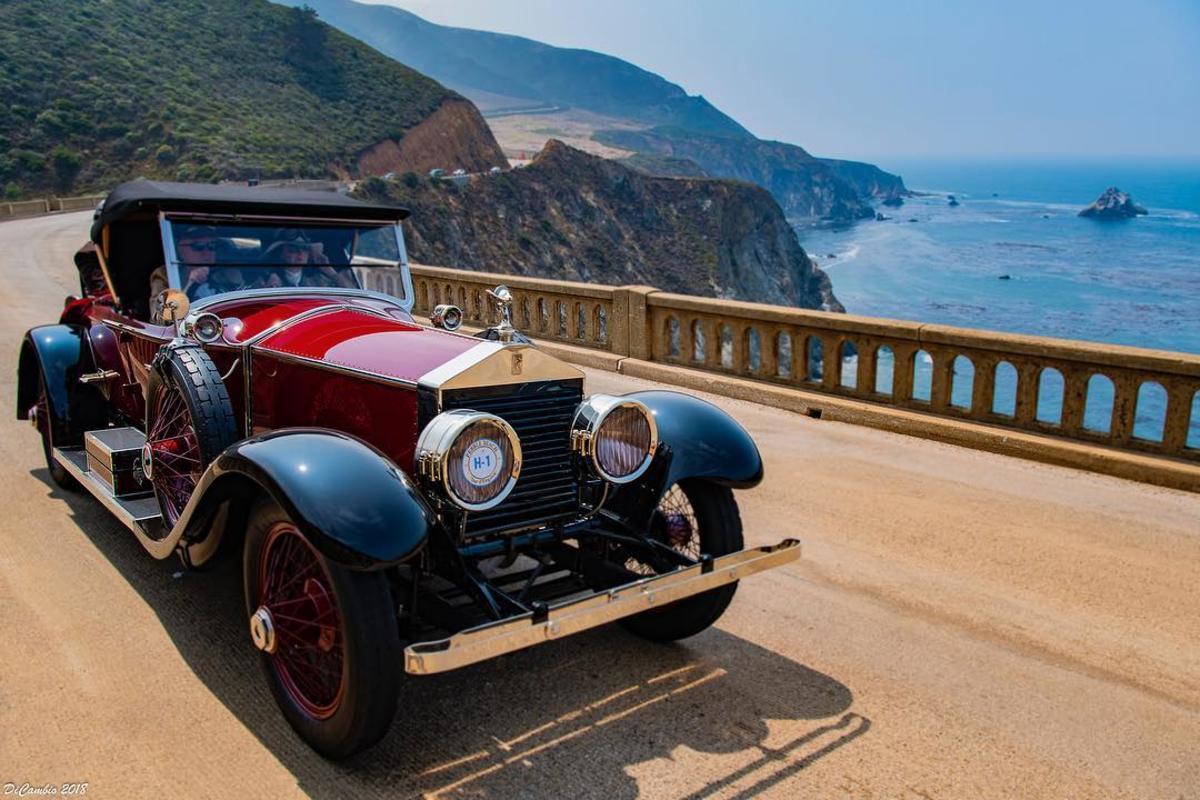 Classic car cruising along the coast during Monterey Car Week