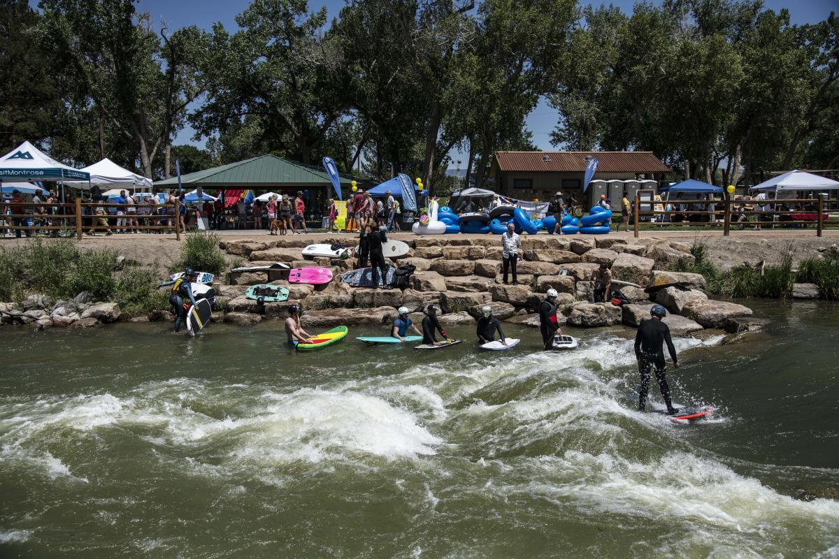 Surfers in the Montrose Water Sports Park on the Uncompahgre River at FUNC Fest.