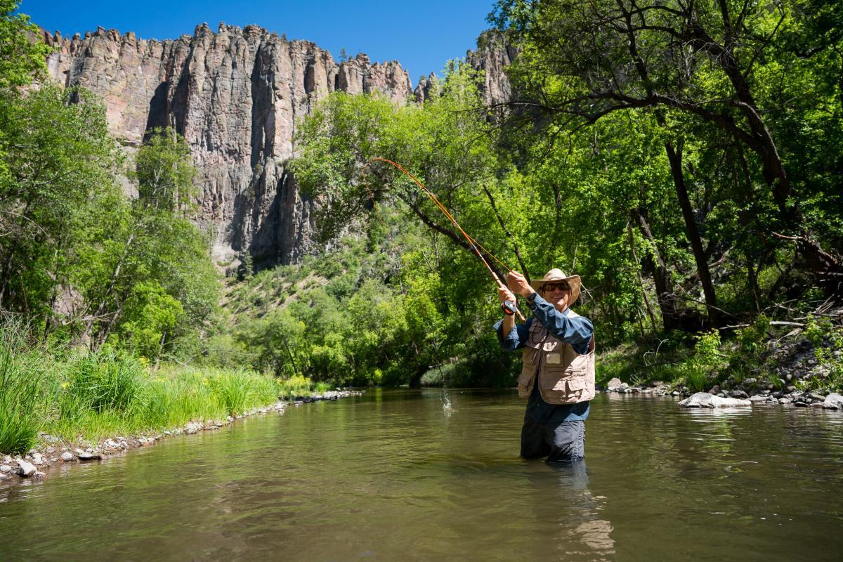 An angler enjoys fishing in the Gila River.
